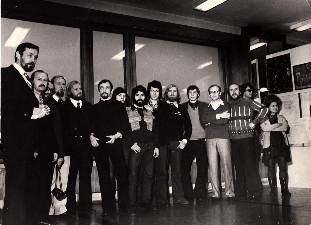 Group portrait before the opening of the first non-conformist show, Leningrad, 1974. Sasha Okun at the center of the group.
